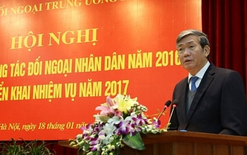 party official calls for improving people to people diplomacy