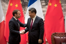 french president calls for trade balance in visit to china