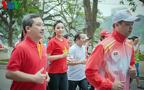 olympic run day raises awareness of physical exercise