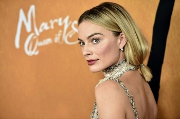 margot robbie to portray barbie in first live action film