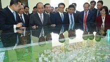 pm urges facilitating land clearance for hoa lac hi tech park