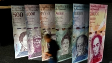 venezuela announces 996 percent devaluation of official forex rate