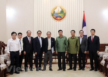 laos pledges to facilitate vietnamese firms investment in agriculture