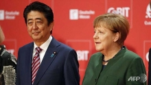 abe merkel call for open markets
