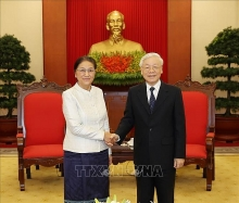party and state leader hosts lao top legislator