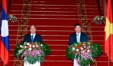 vietnamese lao prime ministers agree to lift ties