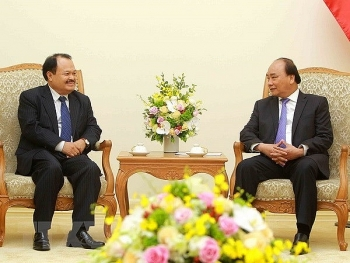 vietnam laos forge stronger cooperation in power mining