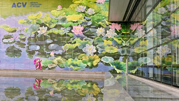 lotus paintings at noi bai airport win gold at international design contest