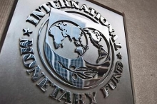 imf lowers forecast for us economy amid rising policy uncertainty