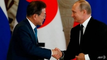 putin invites two koreas to economic summit
