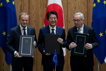 eu japan sign major trade deal in message against protectionism
