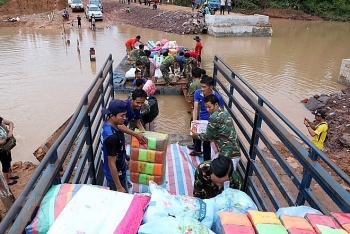 more aid from vietnam reaches survivors of lao dam collapse