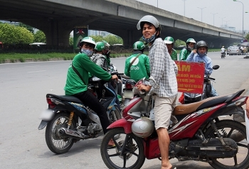 grabbike drivers slam on the brakes in hanoi to strike against pay cut