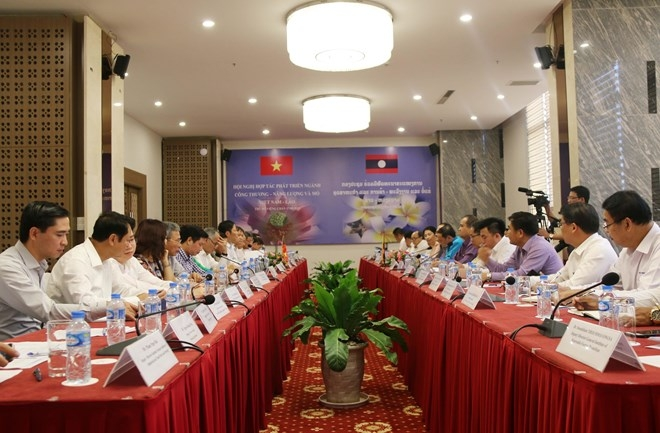 vietnam laos boost cooperation in trade industry energy mining