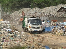 con dao stops shipping waste to mainland