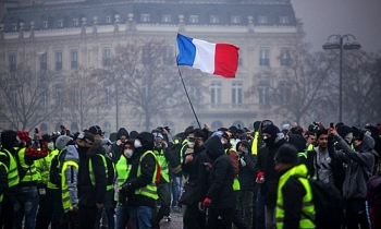 france suspends fuel tax hike for six months to quell protests