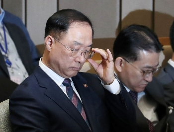 south koreas incoming finance minister says economy losing momentum