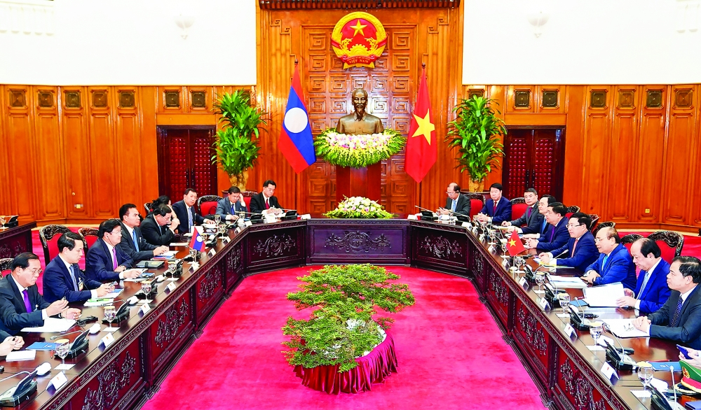 vietnam laos seek to boost trade by 10 15 percent