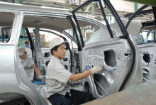 policy change sought to help auto industry compete with imports