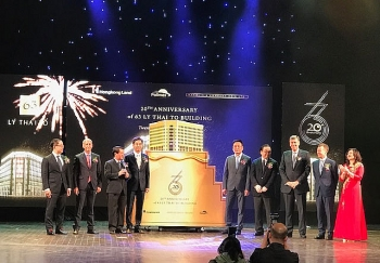 hongkong land celebrates 20 years of 63 ly thai to building goes into operation