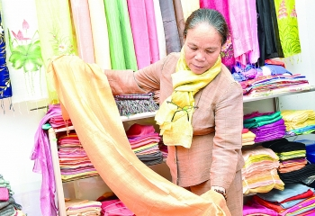 artisan phan thi thuan who trained silkworms now makes silk from lotus stems