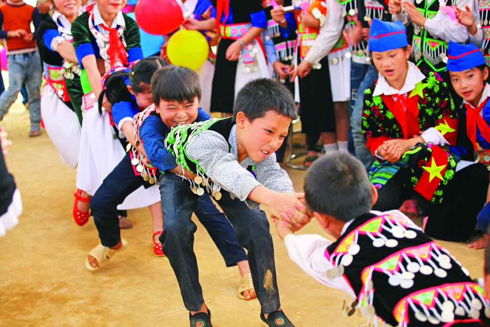 children cheer school opening in na ngoi commune