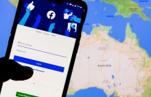 views from experts about unprecedented tension between facebook and australia government