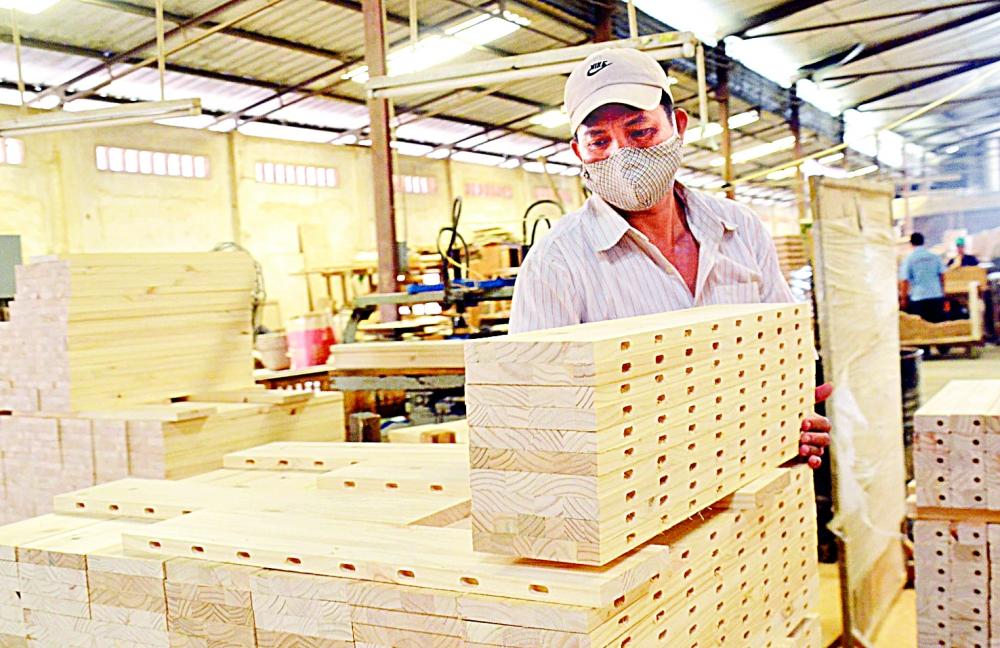 pandemic shaves off up to 80 percent in orders for timber refined wood