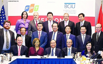 pm woos us investors with securities market appeal