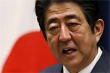 pm abe japan no longer in deflation