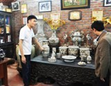 bat trang pottery village survives market storm
