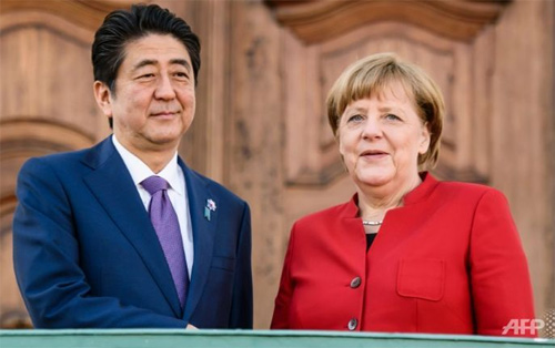 Merkel, Abe differ on how to fix world economy