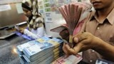 indonesia lowers economic growth target to 55 percent