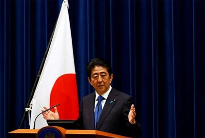 Japan PM delays sales tax hike, puts fiscal reform on back burner