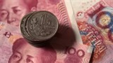 china further devalues yuan currency