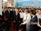 party leader visits exhibition on socioeconomic achievements