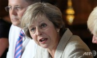 may wants britain to be global leader in free trade