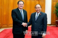 vietnam laos accelerate investment projects