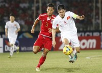 vinhs goal seal viet nams first win at aff cup